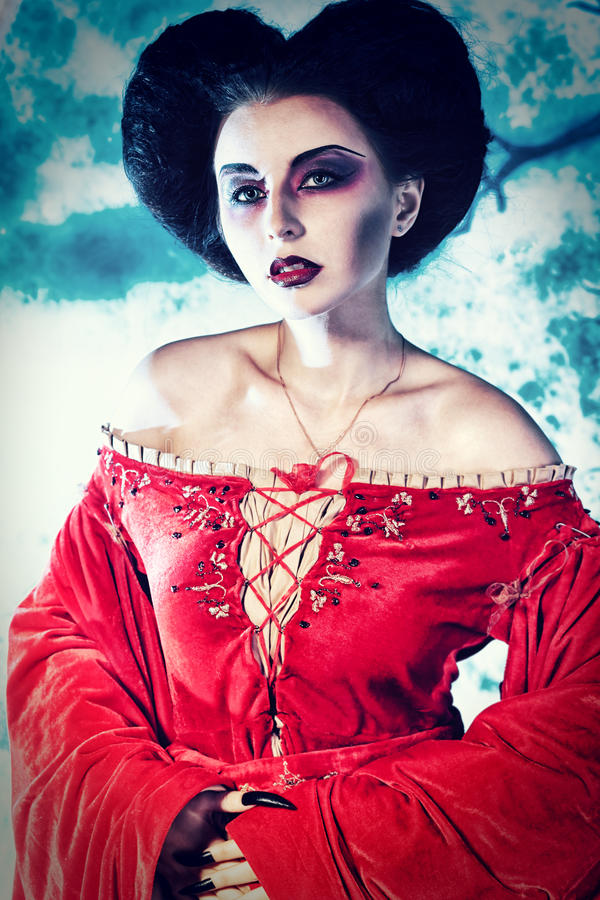 Beautiful vampire. Portrait of a beautiful female vampire over moonlight background royalty free stock images