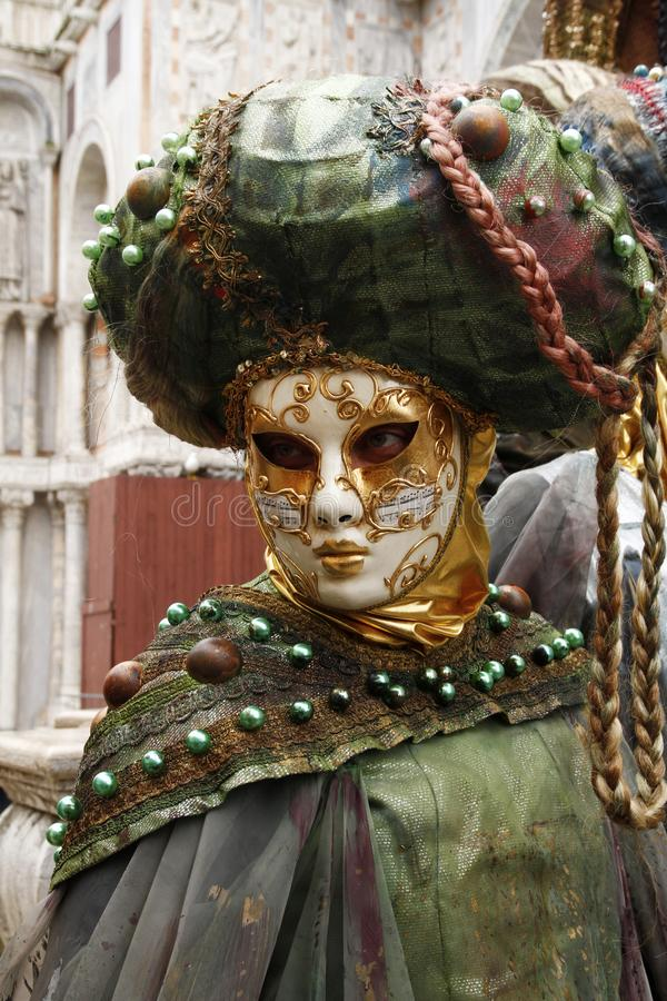 Beautiful venetian mask at St. Mark square during the carnival of Venice. Italy stock photo