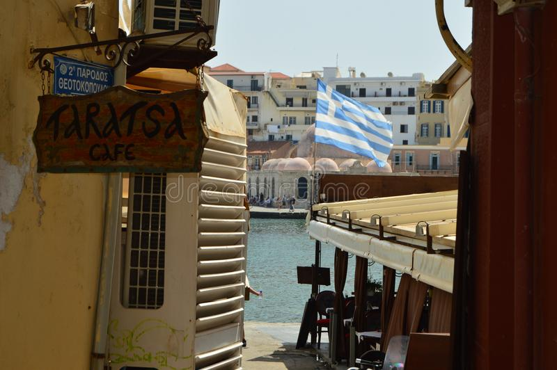 Beautiful Venetian Style Buildings With The Beautiful Flag Of Greece In The Harbor Neighborhood In Chania. History Architecture Tr stock image