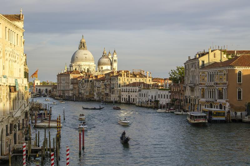 Evening venice, lights, gondolas and canal royalty free stock image