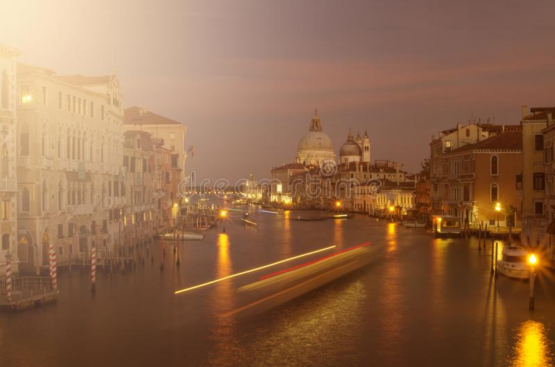 Evening venice, lights, gondolas and canal stock images