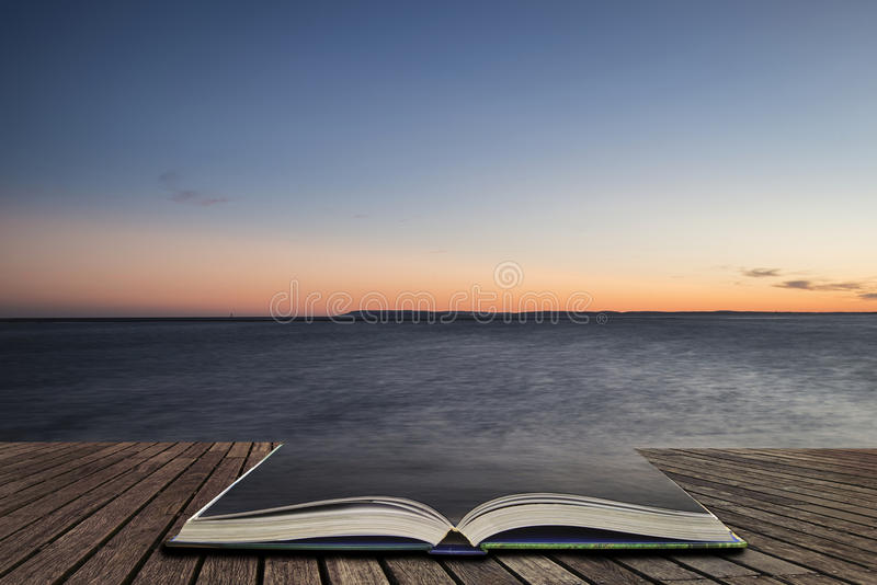 Beautiful vibrant Spring sunset long exposure beach landscape co. Beautiful Spring sunset long exposure beach landscape concept coming out of pages in open book stock photos