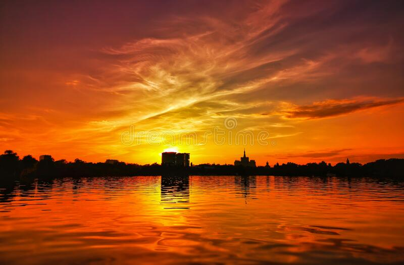 Beautiful vibrant sunset scene in Bucharest, Herastrau Park stock photos