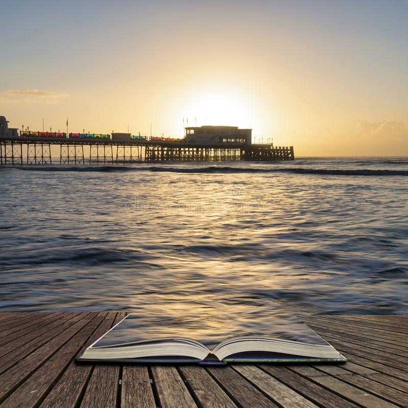 Free Beautiful Vibrant Sunrise Landscape Image Of Worthing Pier In West Sussex During Winter In Pages Of Open Book, Story Telling Royalty Free Stock Photo - 143346085