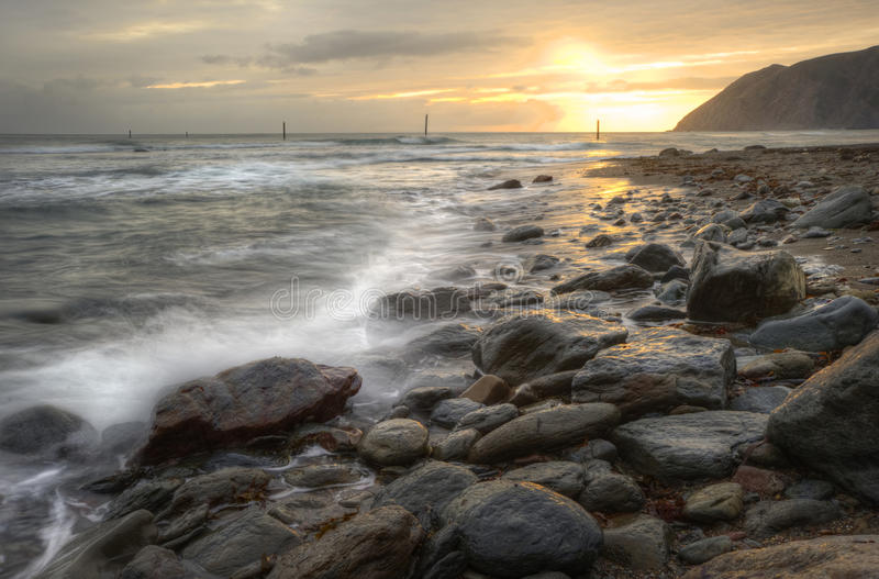 Download Beautiful Vibrant Sunrise Over Ocean With Rocks Stock Photo - Image: 20042118