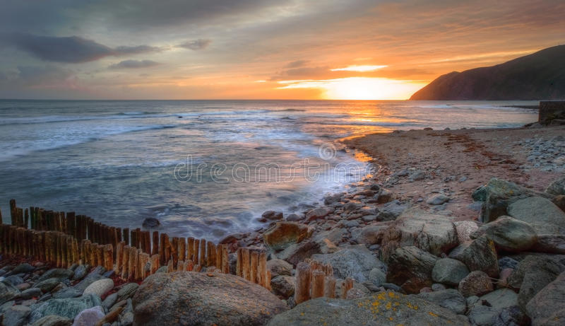 Download Beautiful Vibrant Sunrise Over Rocky Beach Royalty Free Stock Image - Image: 24794036