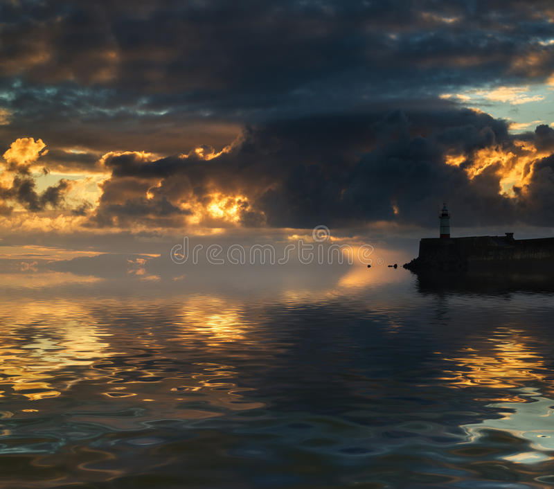 Download Beautiful Vibrant Sunrise Sky Over Calm Water Ocean With Lightho Stock Images - Image: 37752954