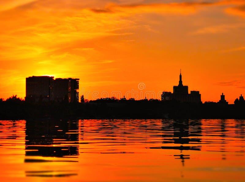 Beautiful vibrant sunset scene in Bucharest, Herastrau Park royalty free stock photo
