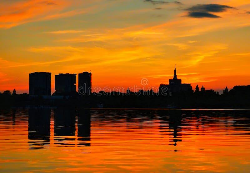 Beautiful vibrant sunset scene in Bucharest, Herastrau Park royalty free stock images