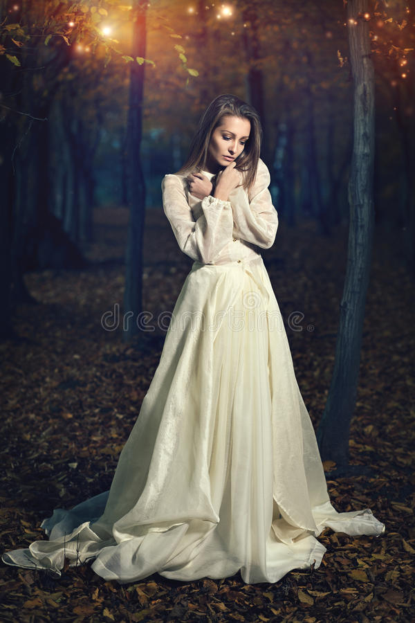 Beautiful victorian dressed woman in fairy forest. Romantic and fantasy royalty free stock images