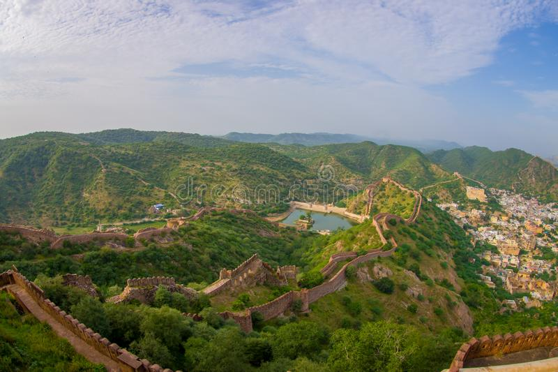 Beautiful view of the Amber fort in Rajasthan in Jaipur India with a stoned walls protecting the ancient indian palace. Fish eye effect stock photography