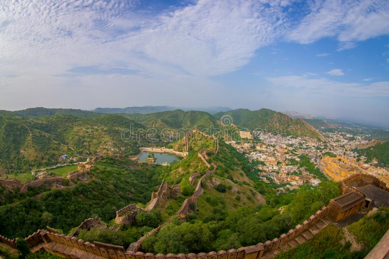 Beautiful view of the Amber fort in Rajasthan in Jaipur India with a stoned walls protecting the ancient indian palace. Fish eye effect stock photo