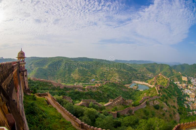 Beautiful view of the Amber fort in Rajasthan in Jaipur India with a stoned walls protecting the ancient indian palace. Fish eye effect royalty free stock images
