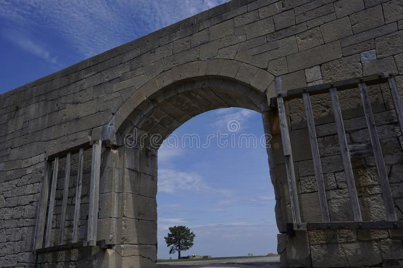 Beautiful view through Arch entrance of old fort wall. Fort Niagara royalty free stock photos