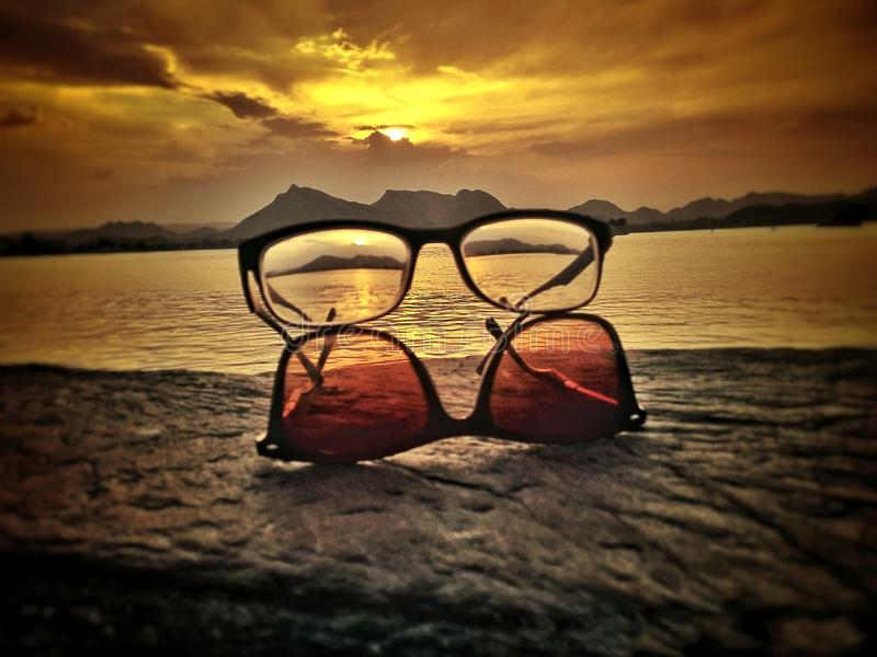 Creative with sunglasses at the border of lake fathesagar Udaipur India stock photography