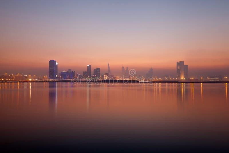 Bahrain skyline at sunset royalty free stock photo