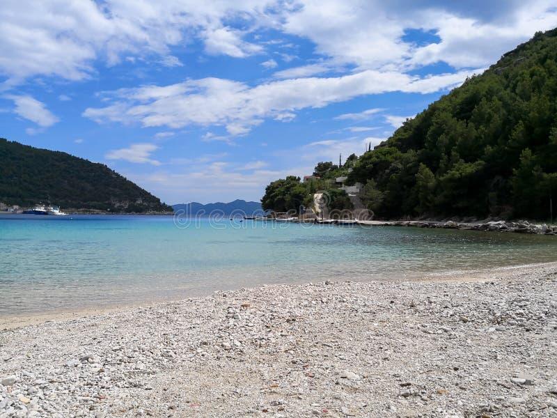 A peaceful beach in croatia. A beautiful view of a beach on the adriatic coastline of croatia mediterranean resort sea dalmatia bay tourism blue travel landscape royalty free stock photo