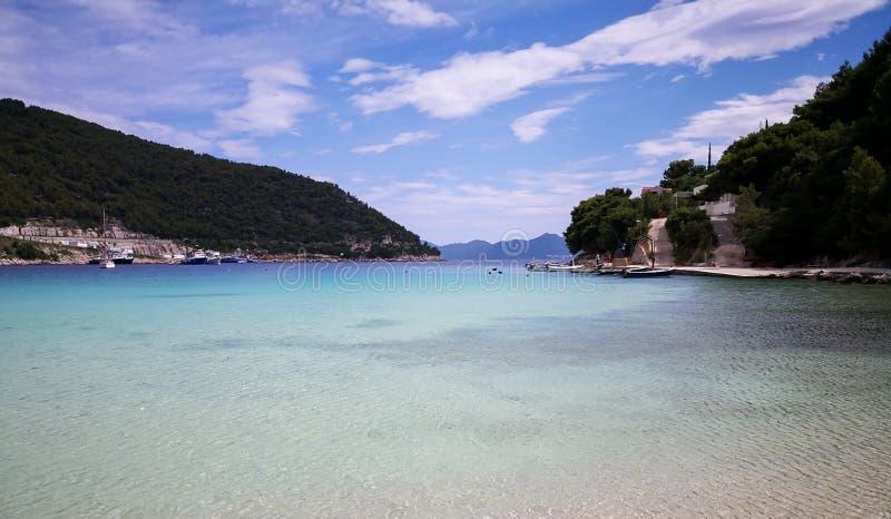 A peaceful beach in croatia. A beautiful view of a beach on the adriatic coastline of croatia mediterranean resort sea dalmatia bay tourism blue travel landscape royalty free stock photos
