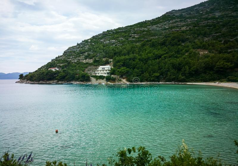 A peaceful beach in croatia. A beautiful view of a beach on the adriatic coastline of croatia mediterranean resort sea dalmatia bay tourism blue travel landscape stock images