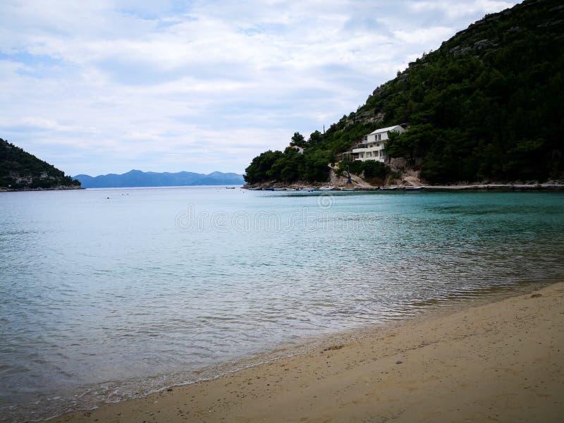 A peaceful beach in croatia. A beautiful view of a beach on the adriatic coastline of croatia mediterranean resort sea dalmatia bay tourism blue travel landscape stock photography
