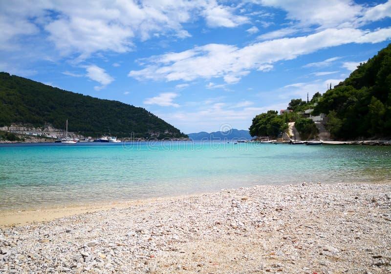 A peaceful beach in croatia. A beautiful view of a beach on the adriatic coastline of croatia mediterranean resort sea dalmatia bay tourism blue travel landscape stock image