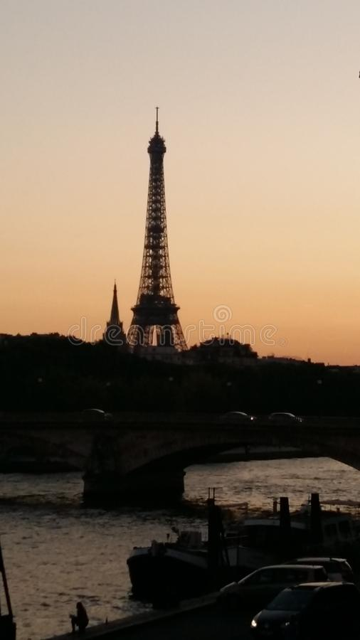 We were stay in Paris! Eiffel Tower at Sunset from Siena River stock photo