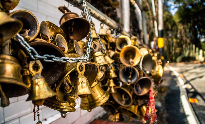Holy Hanging Bells. A beautiful view of bells hanging in a temple stock images
