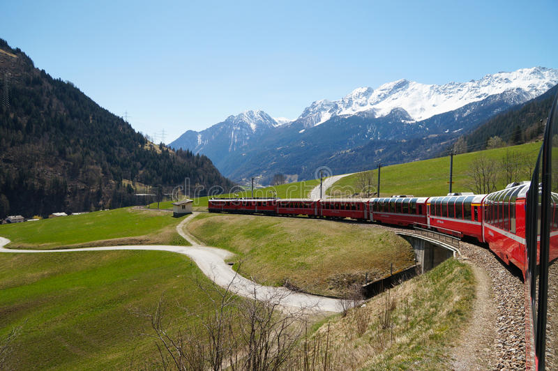 Beautiful view and Bernina express train from Switzerland to Tirano stock photo