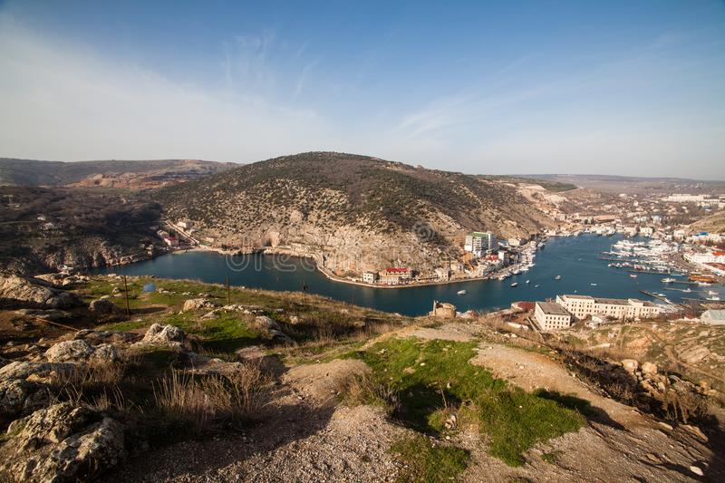 Beautiful view of the Black Sea and the city Balaklava. Balaklava Bay. Clear sunny day and a top view of the port, Crimea. Beautiful view of the Black Sea and royalty free stock image