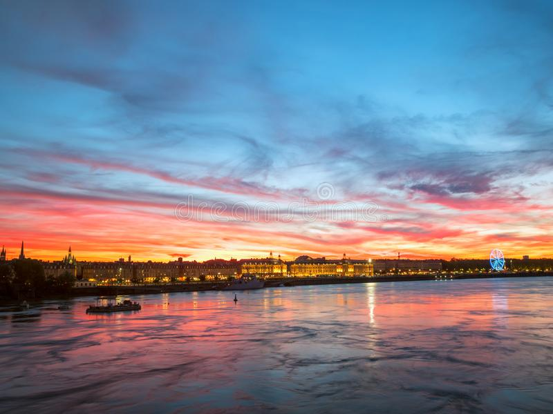 Beautiful view of Bordeaux city and the garonne river with amazing dramatic sunset sky. royalty free stock photos