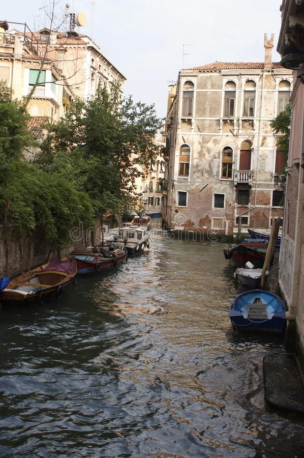 Venice, Italy canal and boats. Beautiful view of a canal and architecture in Venice, Italy royalty free stock images