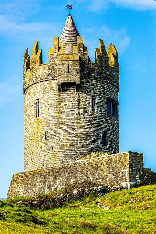 Beautiful view of the Doonagore castle tower over the coastal town of Doolin. Wild Atlantic Way, sunny spring day in county Clare in Ireland royalty free stock images