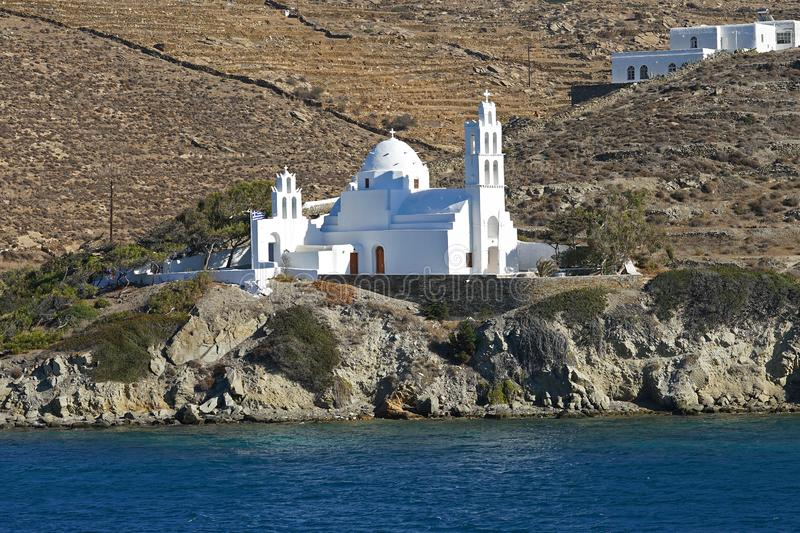 Beautiful view of the church of Agia Irini at the entrance to the port of Ios, Greece stock image
