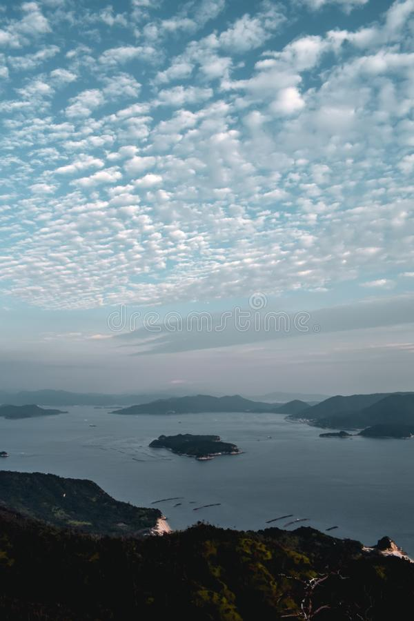 Beautiful view on cloudy sky and pearl farms from Mount Misen at Miyajima island in Hiroshima Japan stock image
