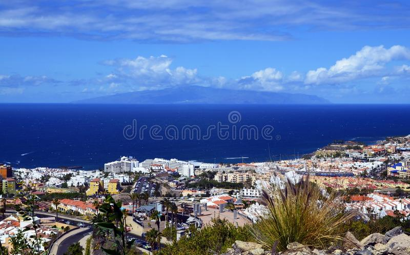 Beautiful view on Costa Adeje and Atlantic ocean with La Gomera island on the horizon in Tenerife,Canary Islands,Spain. Summer vacation or travel concept royalty free stock photo