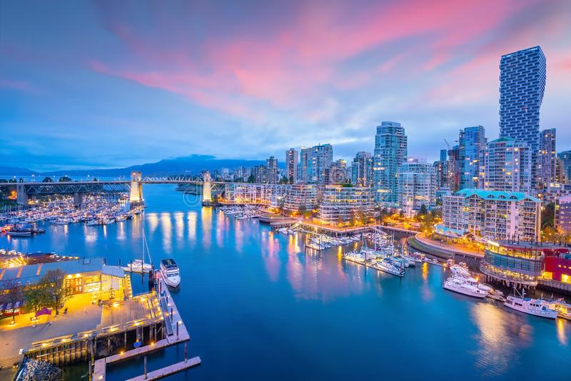 Beautiful view of downtown Vancouver skyline, British Columbia, Canada. At sunset stock photos