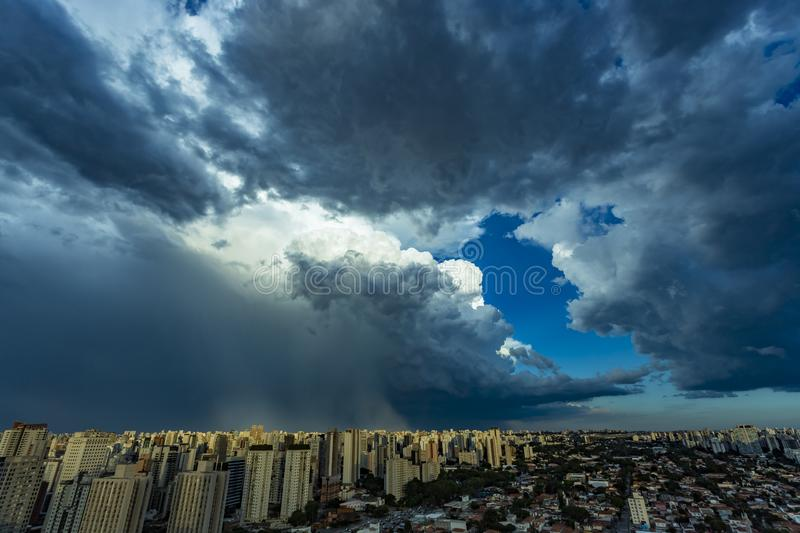 Beautiful view of dramatic dark stormy sky. The rain is coming soon. Pattern of the clouds over city. Very heavy rain sky in Sao Paulo city, Brazil South stock photo