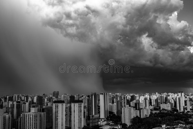 Beautiful view of dramatic dark stormy sky. The rain is coming soon. Pattern of the clouds over city. Very heavy rain sky in Sao Paulo city, Brazil South royalty free stock image