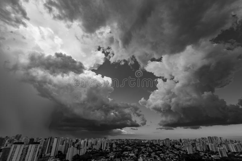 Beautiful view of dramatic dark stormy sky. The rain is coming soon. Pattern of the clouds over city. Very heavy rain sky in Sao Paulo city, Brazil South stock photography