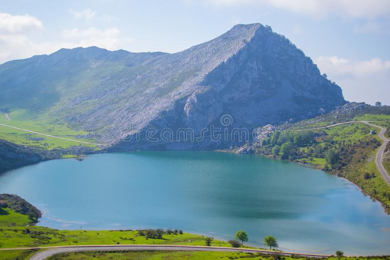 Beautiful view of Enol Lake in Covadonga Lakes, Asturias, Spain. Green grassland with mountains at the background.  royalty free stock photo
