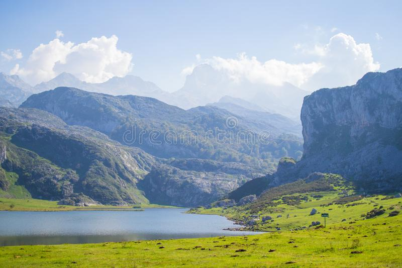 Beautiful view of Ercina Lake in Covadonga Lakes, Asturias, Spain. Green grassland with mountains at the background.  royalty free stock photo