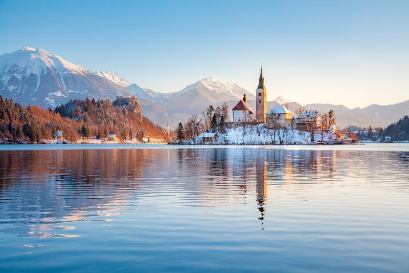 Lake Bled with Bled Island and Castle at sunrise in winter, Slovenia royalty free stock photography