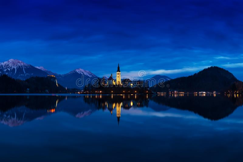 Beautiful view of famous Bled Island with Catholic Church at scenic Lake Bled with Bled Castle Blejski grad and Julian Alps. royalty free stock images