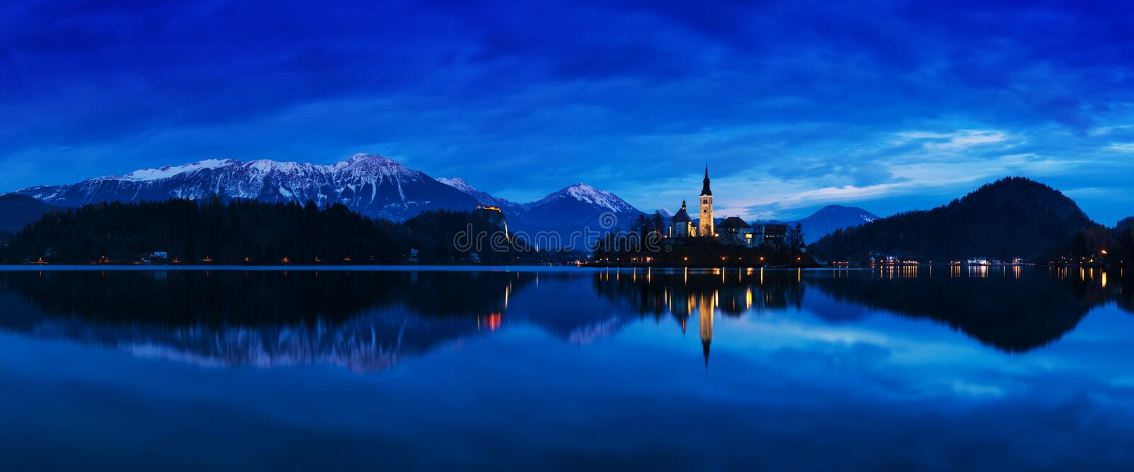 Beautiful view of famous Bled Island with Catholic Church at scenic Lake Bled with Bled Castle Blejski grad and Julian Alps. Beautiful view of famous Bled royalty free stock photos