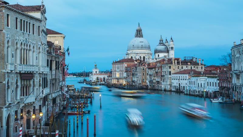 Beautiful view on Basilica di Santa Maria della Salute in golden evening light at sunset in Venice, Italy stock images
