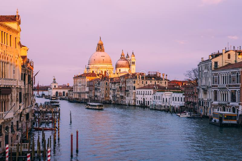 Beautiful view on Basilica di Santa Maria della Salute in golden evening light at sunset in Venice, Italy royalty free stock photography