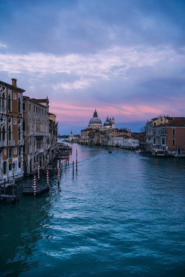 Beautiful view on Basilica di Santa Maria della Salute in golden evening light at sunset in Venice, Italy. Beautiful view on famous Canal Grande with Basilica di stock image