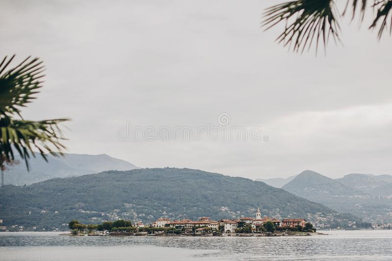 Beautiful view on Fisherman`s Island from Stresa, vacation in Italy. Isola dei Pescatori on Lago Maggiore in sunny day on royalty free stock photography