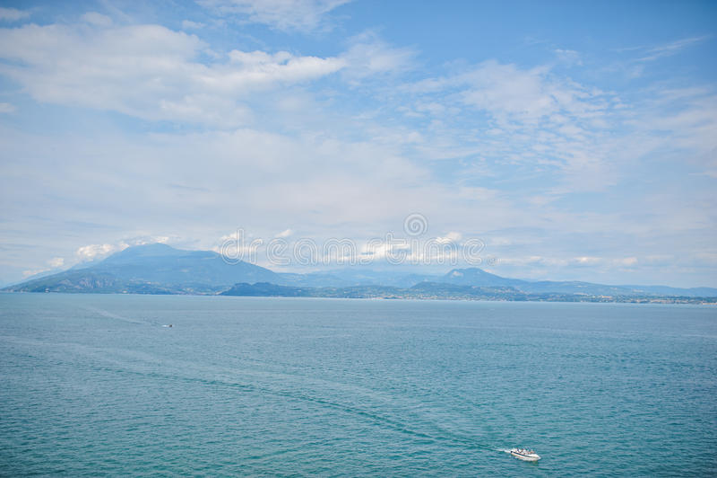 Beautiful view on Garda Lake, Sirmione, Italy. Beautiful sky, water and mountains view on Garda Lake, Sirmione, Italy stock photo