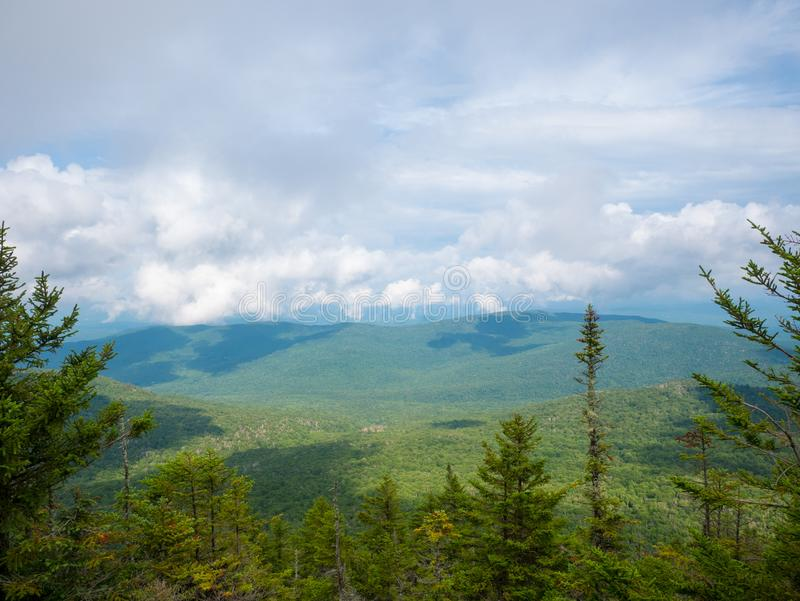 Beautiful view of the Green mountains from the top of a mountain in Vermont, during a summer day.  stock photography